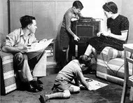 Family listening to radio in living room