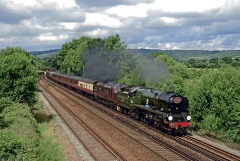 Supported by West Coast diesels front and rear for operational reasons, SR Pacific No. 34052 Lord Dowding is seen near Sevenoaks with Steam Dreams' 'Cathedrals Express' from Victoria to Deal on July 24.PETER HOLLANDS