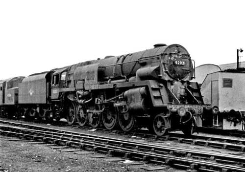 One of the modified Franco-Crosti boilered 9Fs, No. 92021, with smoke deflector added around the final chimney. It was the drifting smoke problem with the original 10 locomotives that necessitated the diversion to Wellingborough in December 1955 of Nos. 92060-92066, which had been earmarked for Tyne Dock. No. 92021 is looking in a very sorry state at Derby shed on April 24, 1960.