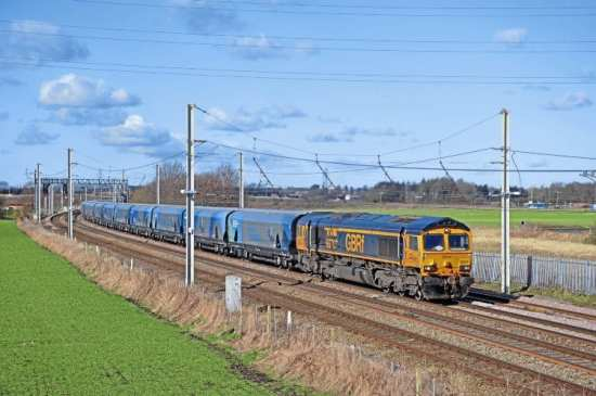 Working out of Liverpool Biomass Terminal, GBRf Type 5 No. 66707 Sir Sam Fay passes Old Alder Lane bridge, Winwick, on February 23, on its way to Drax. DOUG BIRMINGHAM