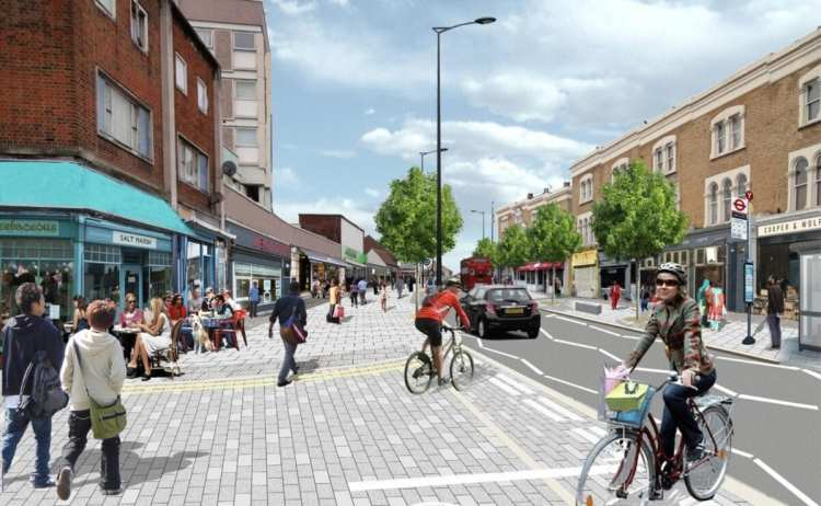 Smiley cyclists, happy pedestrians and wide pavements – artist's impression of a traffic-calmed high street (Transport for London)
