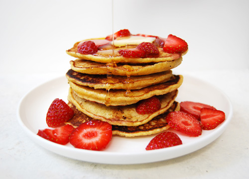 Strawberry cornmeal pancakes with butter and syrup