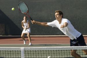 Mixed Doubles Player Reaching For Ball