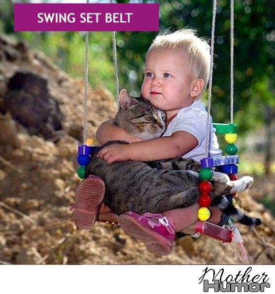 Baby on swing with cat