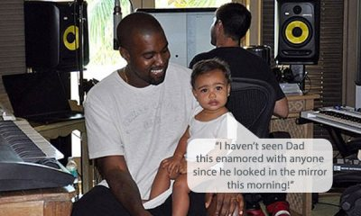 Picture of Kanye West smiling with North West on lap