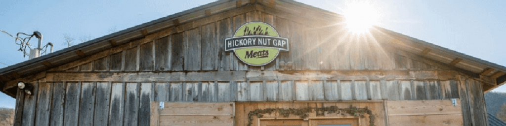 Image of Hickory Nut Gasp Farm Store top and roof with sun shining over
