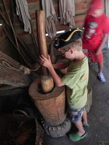 Grinding corn at Great Hopes Plantation