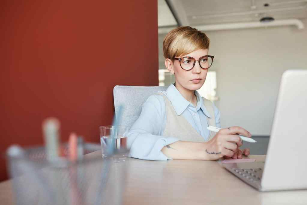 Successful Female Entrepreneur Working with Laptop