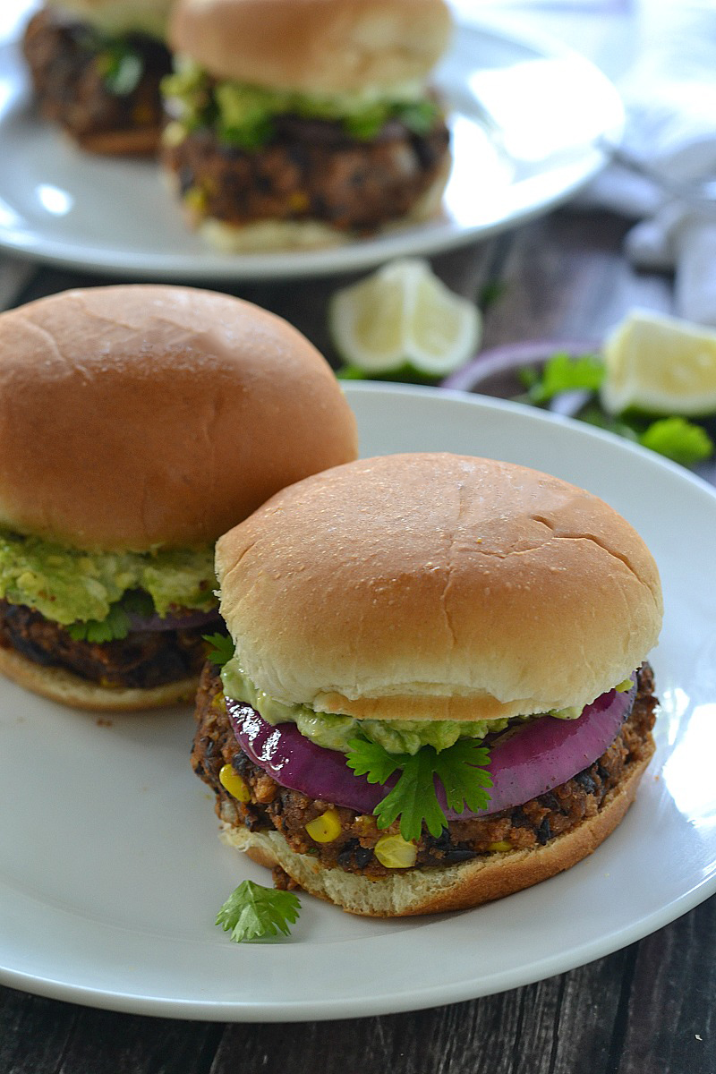 Black Bean Sliders/Burgers topped with a creamy avocado mayo, smashed avocado and red onion - so good! | www.motherthyme.com