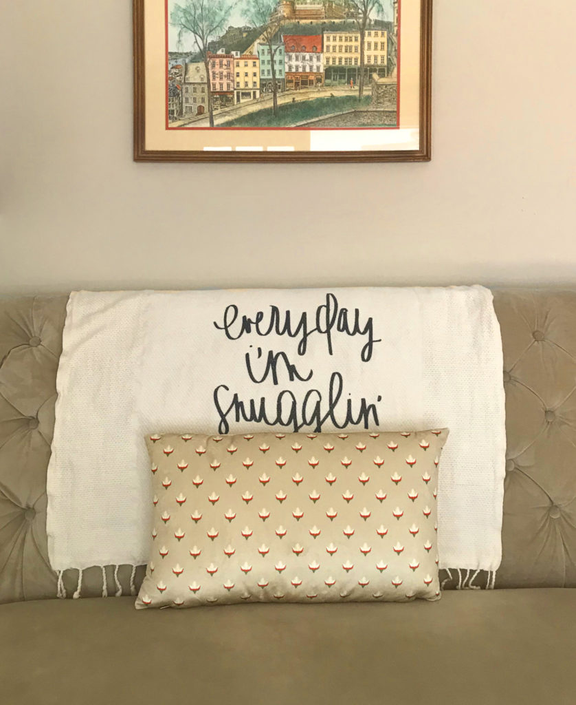 floral bud block print velvet pillow on tufted bench snuggling blanket
