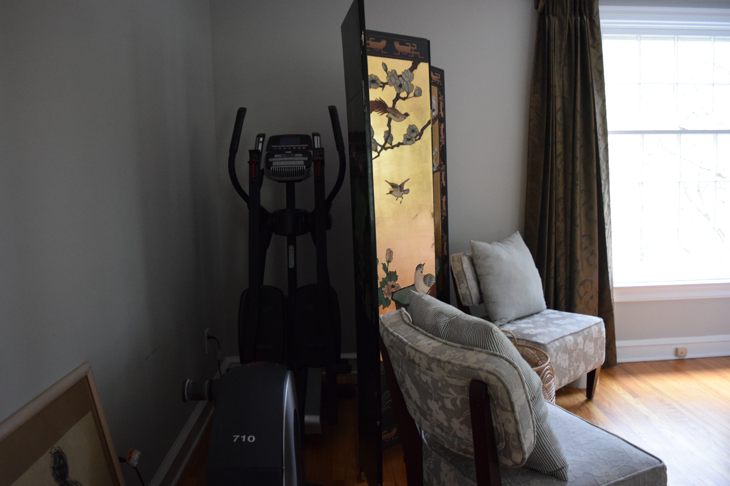hiding our elliptical behind chinoiserie screen and chairs