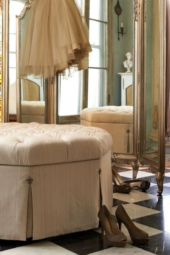 mirrored folding screen in dressing area with ottoman