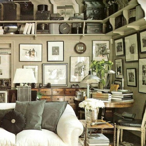 black and white frame gallery wall and table with books in living room