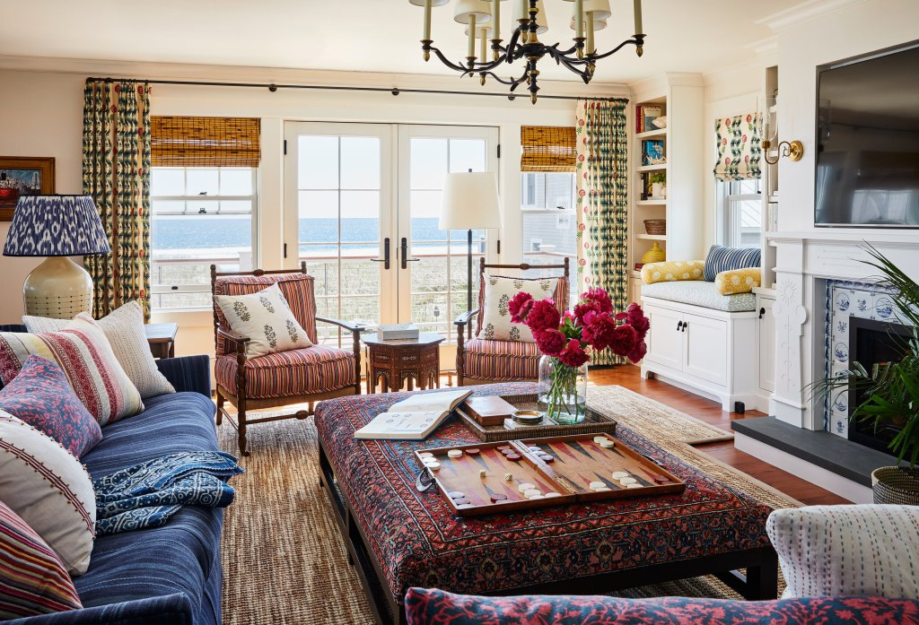 beachfront living room with blue sofa and French doors