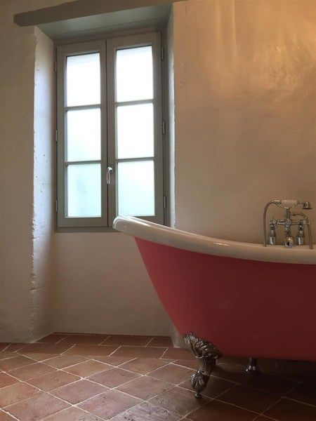 green window trim in plaster bathroom with red tub farrow and ball