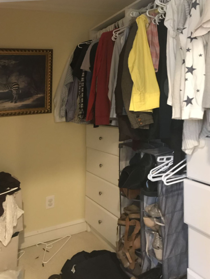messy hanging clothes and drawers in walk in closetbefore purge