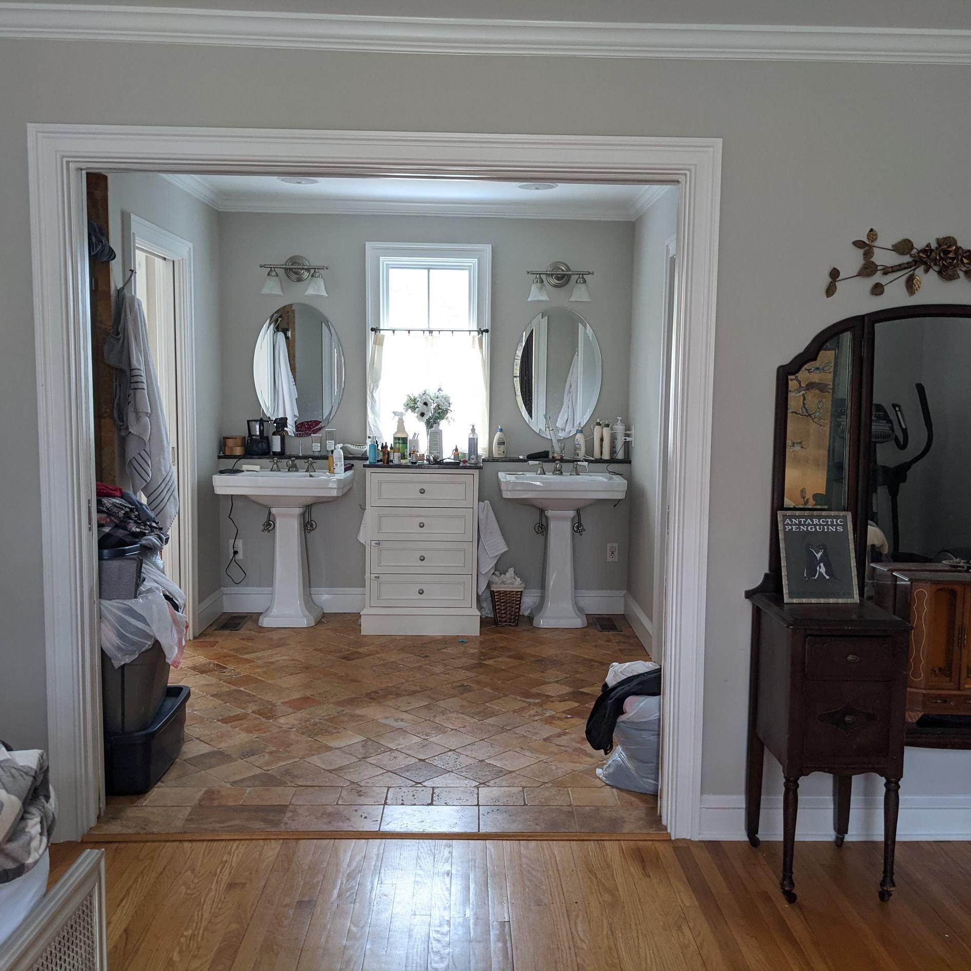 primary suite master bathroom pedestal sink vanity