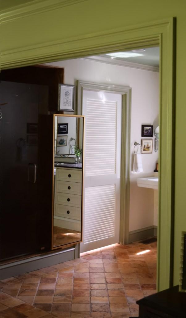 floating full length mirror in master bedroom en suite