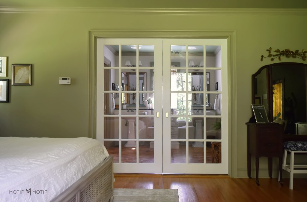 white French pocket doors in French gray bedroom