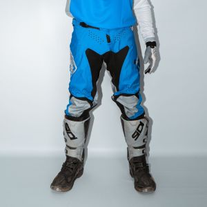Front of adult blue engage motorsports pants