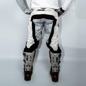 Back of adult white engage motorsports pants