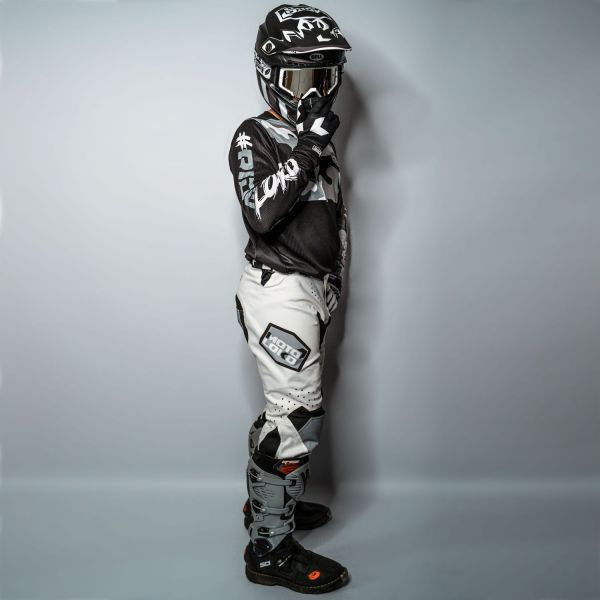 Side view of model wearing a complete white camo motocross kit with hand on mouth