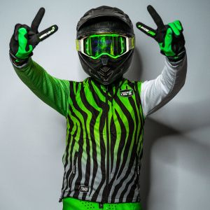 Front view of model wearing green bodywarmer, gloves and helmet with double peace sign