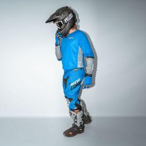 side view of model wearing blue fresh motorsports kite