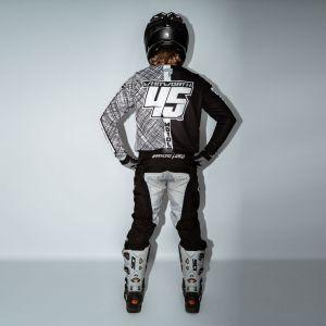 model wearing black scribble motorsports kit showing the back view