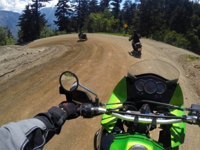 POV of two motorcycle riders on tour from the guides camera