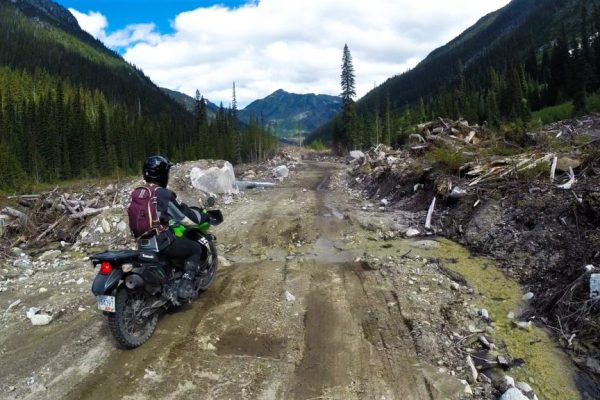 KLR riding down a dirt road just outside of Pemberton