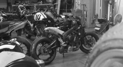 Looking naked amongst Roland's bikes