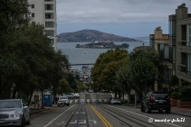 View down the streets on Fishermans Wharf harbour and Alcatraz