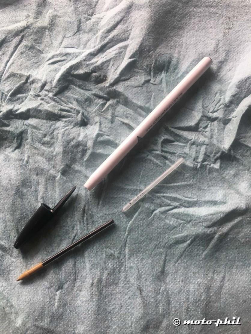 A biro taken apart to replace a Tutoro chain oiler nozzle