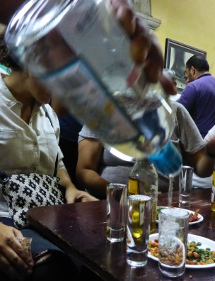 """Pouring of mexican Tequila in """"La Fuente"""" a classic mexican Cantina in Guadalajara"""