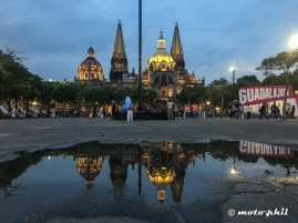 Catedral de Guadalajara and it's reflection in a puddle seen from the Liberation Square by night