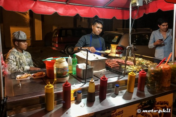 Mexican hot dog stand by night in the streets of Guadalajara