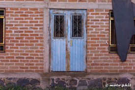 Blue door of a enmpty brick building in Santa Elena, Jalisco