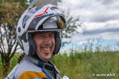 German GS rider with his Caberg flip up helmet smiling