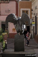 Statue of a naked man with wings from the back