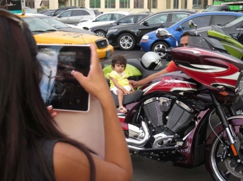 A lot of people in Vegas are under the impression the whole town is some kind of playground. Sure, why not shoot a picture of your kid on my motorcycle? Has anybody ever told you he looks just like Maurice Gibb? She. Sorry.