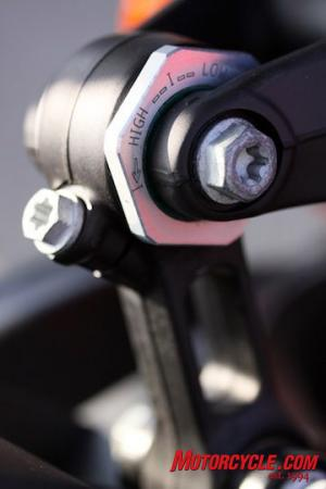 This eccentric on the shock linkage allows easy ride-height adjustments.