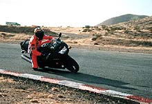 """(Sung to the tune """"No Particular Place To Go"""" by Chuck Berry) """"Riding along on my ZX-6R ..."""""""