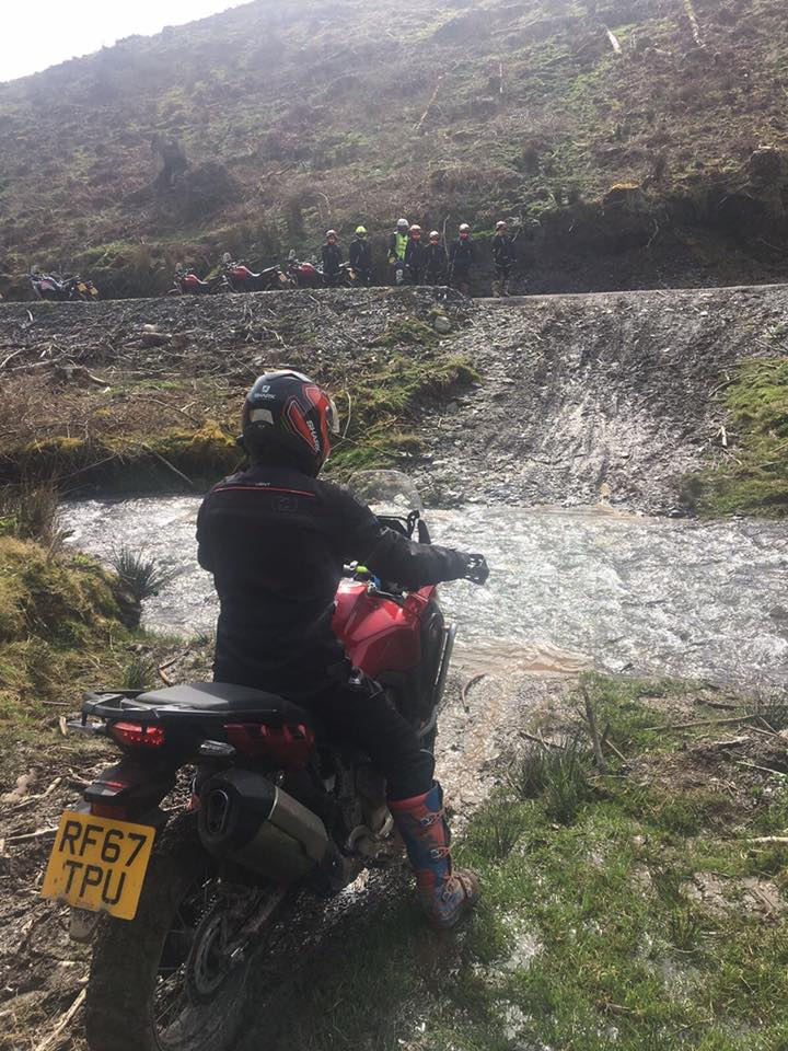 Me on my adventure bike crossing a raging river. Using story-telling to document your motorcycle trip is important