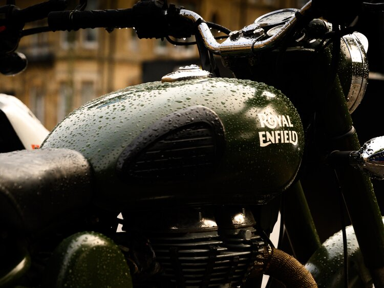royal enfield in rain - motorcycle touring rain gear