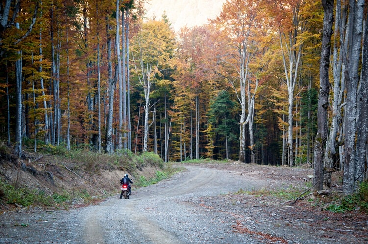 can touring motorcycles go off-road? biker on gravel track