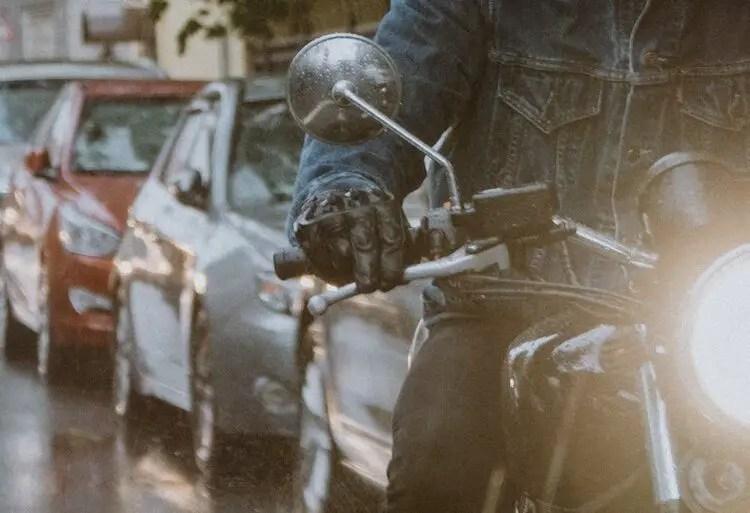 biker braking smoothly in the rain