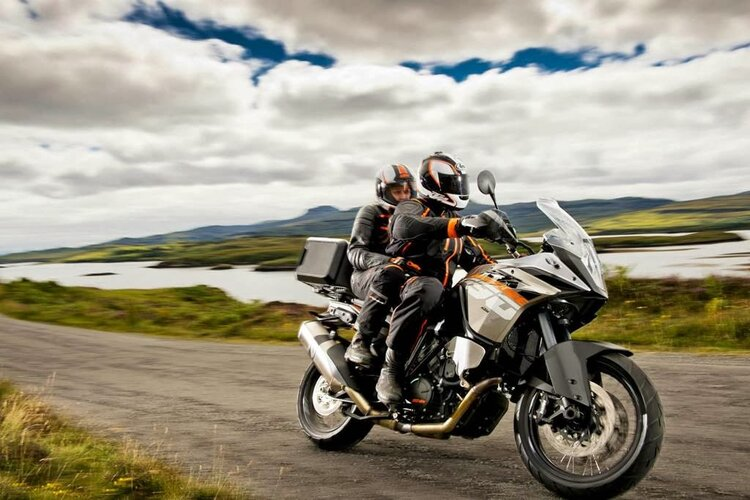 ktm with pillion riding off-road