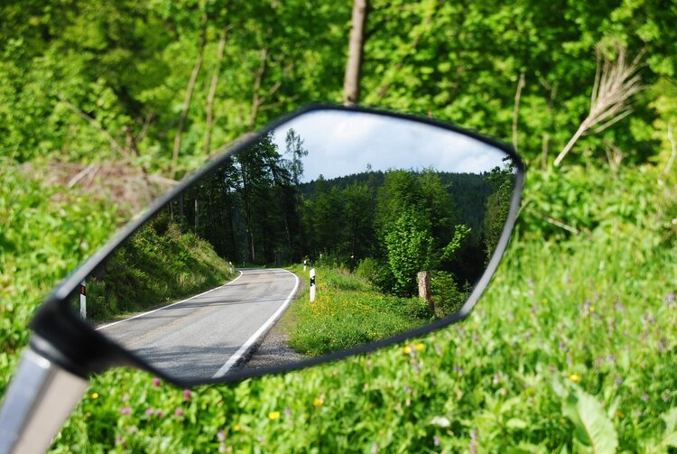 rear mirrors and observation keep you safe when riding your motorcycle in wet weather