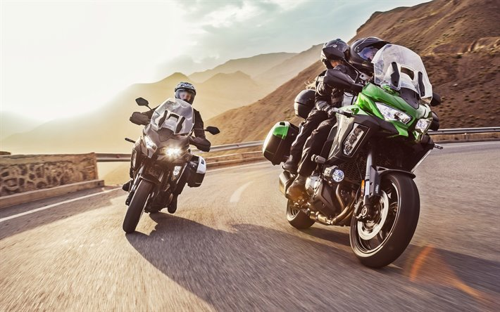 2 bikers riding mountain roads